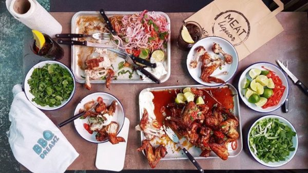 A flat lay of dishes offered by BBQ Dreamz